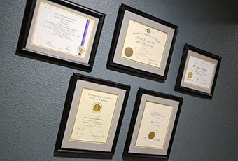 Certificates hanging on wall