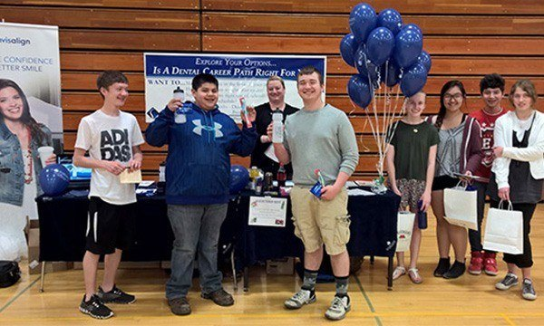 Students visiting table at career fair