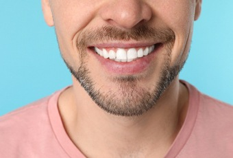 man's straight teeth