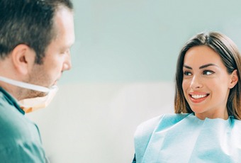patient talking to dentist