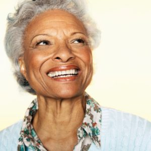 senior woman with a beautiful smile thanks to the dental implants ripon residents rely on