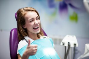 A woman smiling at her dental visit.